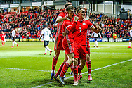 Wales midfielder Ben Woodburn scores and celebrates with his teammates a goal 1-0 during the Friendly European Championship warm up match between Wales and Trinidad and Tobago at the Racecourse Ground, Wrexham, United Kingdom on 20 March 2019.