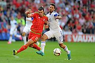 Gareth Bale of Wales holds off Israel's Orel Dgani.. Euro 2016 qualifying match, Wales v Israel at the Cardiff city stadium in Cardiff, South Wales on Sunday 6th Sept 2015.  pic by Andrew Orchard, Andrew Orchard sports photography.