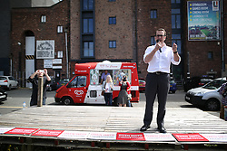 © Licensed to London News Pictures . 30/07/2016 . Liverpool , UK . Owen Smith holds a rally in a field after the booked venue,  the Camp and Furnace warehouse , reportedly cancelled the campaign's booking , in his campaign to replace Jeremy Corbyn as the leader of the Labour Party . Photo credit : Joel Goodman/LNP