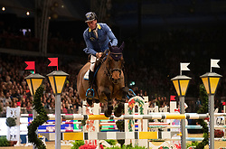 Germany's Christian Ahlmann riding Atomic Z competes in the Snowflake stakes during day four of the London International Horse Show at London Olympia.