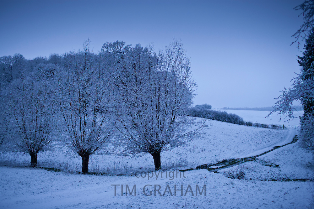 Traditional snow scene in The Cotswolds, Swinbrook, Oxfordshire, United Kingdom