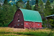 A watercolor style image of a beautiful old barn in Jackson Hole, WY, just south of Grand Teton National Park. The original photo image was captured by Mike R. Jackson on a crispy summer morning.