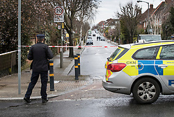© Licensed to London News Pictures. 02/04/2018. London, UK. A police officer stands on Ellerton Road in Wandsworth, south west London, where 20 year old Devoy Stapleton was stabbed to death at 1am on Sunday 1st April - the 31st fatal stabbing this year in the capital. It is being reported that London's murder rate has overtaken New York's.   Photo credit: Peter Macdiarmid/LNP