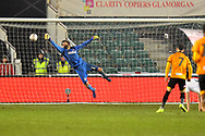 Goal - Robbie Willmott (7) of Newport County scores a goal to give a 1-0 lead to the home team to beat the diving Dimitrios Konstantopoulos (1) of Middlesbrough during the The FA Cup match between Newport County and Middlesbrough at Rodney Parade, Newport, Wales on 5 February 2019.