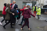 The waxwork of Donald Trump is carried to the US Embassy at Nine Elms in south London on the day when the President announced on Twitter, his refusal to visit London and open the new state premises after its historic move from Grosvenor Square, on 12th January 2017, in London, England. The waxwork is the property of Madame Tussauds and took a team of 20 artists 4 months to create, going on display on the day of his innauguration in 2017. It is valued at £150,000.