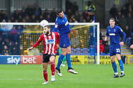 AFC Wimbledon midfielder Anthony Hartigan (8) winning header during the EFL Sky Bet League 1 match between AFC Wimbledon and Lincoln City at the Cherry Red Records Stadium, Kingston, England on 2 November 2019.