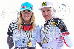 THEMENBILD - Skistar Marcel Hirscher gibt am 4. September seine Zukunftspläne in Salzburg bekannt. Seit seinem ersten Weltcupsieg 2009 in Val d'Isere gewann er den Gesamtweltcup siebenmal in Folge und steht derzeit bei insgesamt 68 Siegen. Damit zählt er zu den erfolgreichsten Skirennläufern der Geschichte. Hier im Bild: Mikaela Shiffrin und Marcel Hirscher (AUT) mit der Kristallkugel für den Sieg im Gesamtweltcup, Saison 2018/2019 // Ski star Marcel Hirscher announces his plans for the future in Salzburg on 4 September. Since winning his first World Cup victory in Val-d'Isere in 2009, he has won the overall World Cup seven times in a row and currently has a total of 68 victories. He is one of the most successful ski racers in history. Here in the picture: Mikaela Shiffrin and Marcel Hirscher (AUT) with the crystal ball for the victory in the overall World Cup season 2018/2019. EXPA Pictures © 2019, PhotoCredit: EXPA/ Erich Spiess
