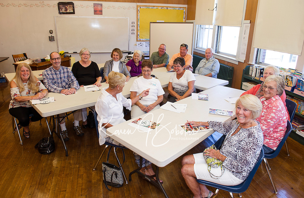Just like old times with a familiar feel for these 1962 St. John's classmates as they take a tour of what is now Holy Trinity School in Laconia on Friday morning.(l-r) back row Sally Adams, Stephen Laurent, Ann Twitchell, Charlene Baker, Joanne (Simoneau) Gustafson, Mike Laramie, Alan Davis, Lee Willette.  (l-r) middle row Maureen O'Connell, Nancy (Savigny) Milton, Jane (Rogers) Allen. (l-r) front row Diane (Weeks) Woodworth, Pam LaRoche and Mary Mudgett.     (Karen Bobotas/for the Laconia Daily Sun)