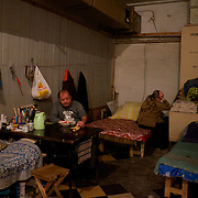 DONETSK, UKRAINE - OCTOBER 16, 2014: An IDP eats his meal in a small room of a Soviet era bomb shelter in Petrovskiy district, Donetsk. More than one hundred people have been living for the past four months at the shelter after heavy fight broke out between DNR rebels and the Ukrainian National Guard, over the control of Donetsk. CREDIT: Paulo Nunes dos Santos