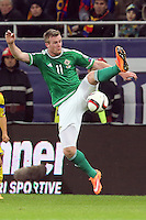 ROMANIA, Bucharest : Northern Ireland's Chris Brunt vie for the ball during the Euro 2016 Group F qualifying football match Romania vs Northern Ireland in Bucharest, Romania on November 14, 2014.