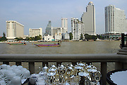 View over Chao Phraya River towards Oriental Hotel (l.) and Shangri-La (r.) from terrace of Peninsula Hotel.