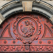 Decorated transom above the main door at the Church of Saint John the Baptist at the Béguinage, 17th century Flemish Baroque style Roman Catholic Church in central Brussels, Belgium. It was originally part of the beguinage Notre-Dame de la Vigne.