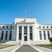 The southern face of the Federal Reserve building on Constitution Avenue in Washington DC, adjacent to the National Mall.
