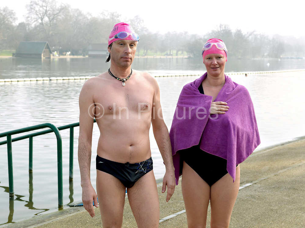 Portrait of members of the Serpentine Swimming Club after swimming, Hyde Park, London, UK. The Serpentine Lake is situated in Hyde Park, London's largest central open space. The Serpentine Swimming Club was formed in 1864 'to promote the healthful habit of bathing in open water throughout the year'.  Its headquarters were beneath an old elm tree on the south side of the lake, a wooden bench for clothing being the only facility.  At this time London was undergoing rapid expansion and Hyde Park was now in the centre of a densely populated built up area and provided a place of relaxation to its urbanised masses. Now, the club has its own (somewhat spartan) changing facilities and members are  permitted by the Royal Parks to swim in the lake any morning before 09:30.  They race every Saturday morning throughout the year, regardless of the weather.