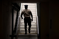 A member of the armed forces makes his way up steps onto centre court on day one of the Wimbledon Championships at the All England Lawn Tennis and Croquet Club, Wimbledon.