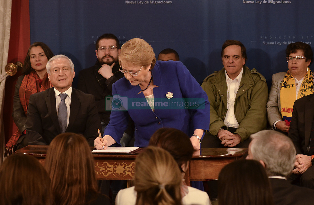 August 21, 2017 - Santiago, SANTIAGO, CHILE - Santiago Chile 21 August 2017. The President of the Republic, Michelle Bachelet, signs a draft new Law on Migration. The initiative has four axes: a system of principles, rights and duties, the regulation of income, exit and migration categories, an administrative sanctioning procedure and a national migration policy system, in order to prevent people from being victims of networks of Trafficking or trafficking. It also establishes a catalog of grounds for prohibiting entry and expulsion from the national territory. Santiago Chile August 21, 2017. LUISVARGAS / ZUMAPRESS  (Credit Image: © Luis Vargas via ZUMA Wire)