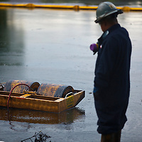 """Oil worker manages """"skimmer"""" to clean up oil spill in Liberty Park, Salt Lake City"""