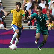 Neymar, Brazil, is challenged by Hiram Mier, Mexico, during the Brazil V Mexico Gold Medal Men's Football match at Wembley Stadium during the London 2012 Olympic games. London, UK. 11th August 2012. Photo Tim Clayton