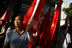 July 1, 2017 - Hong Kong, CHINA - Pro-China supporter exhibit HKSAR flag to show support for the visiting Chinese President Xi Jin Ping during political rally organized by pro-democratic camps condemning Xi Jin Pings visit and demand releasing of Chinese dissident and political prisoner LIU XIAO BO. Today marks 20th anniversary of the Hong Kong HANDOVER to China.July 1,2017.Hong Kong.ZUMA/Liau Chung Ren (Credit Image: © Liau Chung Ren via ZUMA Wire)