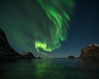 Northern Lights - Aurora Borealis fill sky over Vik beach, Vestvågøy, Lofoten Islands, Norway