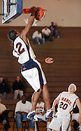 Middletown, N.Y. - Orange County Community College men's basketball player Stefan Bonneau, a 5-foot-9 guard, dunks the ball during a game against Queensborough Community College on Feb. 4, 2006. ©Tom Bushey