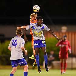 BRISBANE, AUSTRALIA - JANUARY 27: Shaun Carlos of Lions and Denis Yongule of the Strikers compete for a headed ball during the Kappa Silver Boot Grand Final match between Lions FC and Brisbane Strikers on January 27, 2018 in Brisbane, Australia. (Photo by Patrick Kearney)
