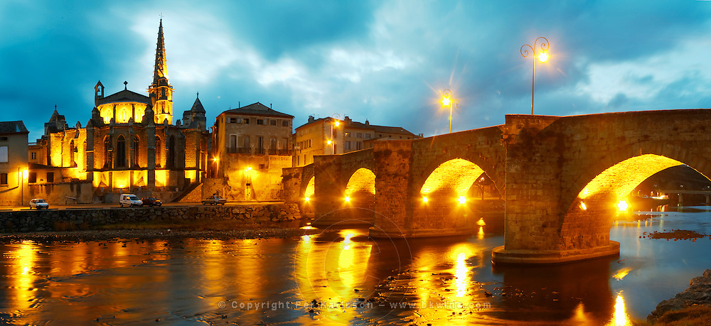 The gothic St Martin Church and the bridge across the l'Aude river. Town of Limoux. Limoux. Languedoc. Aude river. Illuminated at evening time and night. France. Europe.
