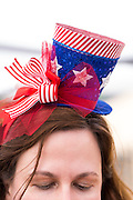 Carolyn Pagin of Bay Area Entertainment Network wears a patriotic hat while creating balloon animals during the Waving the Red, White & Blue Pool Party at the Milpitas Sports Center in Milpitas, California, on July 4, 2014. (Stan Olszewski/SOSKIphoto)