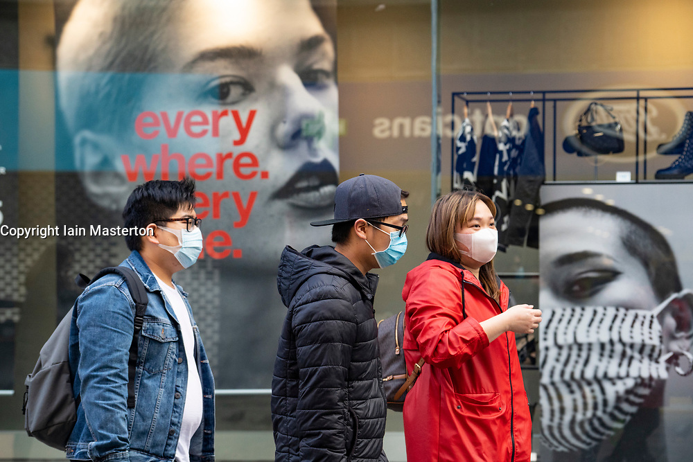 Glasgow, Scotland, UK. 26 October 2020. View of Glasgow city centre on weekday during circuit breaker lockdown with bars and restaurants closed. Pictured; Members of the public wearing facemasks walk past shop window display in Primark store. Iain Masterton/Alamy Live News