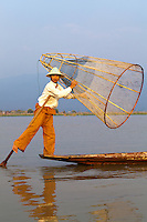 The ethnic Intha people who live around Inle Lake get around by using traditional skiffs propelled by one foot controlled paddle.  The unusual Intha method of leg rowing - one leg wrapped around the paddle which drives the blade through the water.  The Intha make up the bulk of the fishermen on the lake.