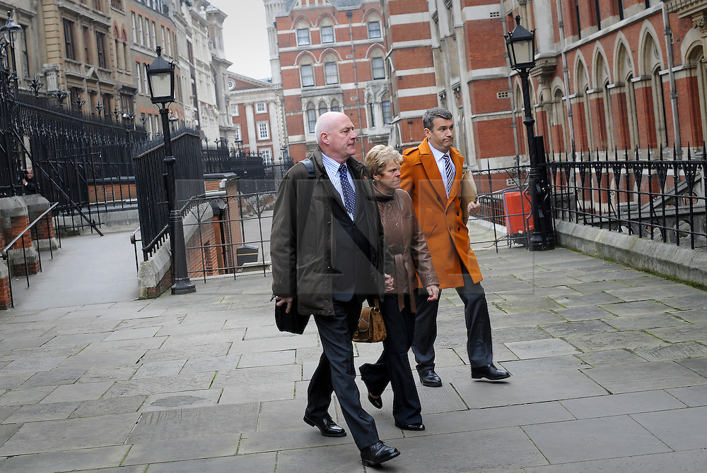 © London News Pictures. 21/11/2011. London, UK.  The parents of the murdered schoolgirl Milly Dowler, L to R Sally Dowler, Milly's mother,  and Robert Dowler, Milly's Father  with Mark Lewis, The Dowlers solicitor (right)  arriving at The Royal Courts of Justice today (21/11/2011) to give evidence at the Leveson Inquiry into press standards. The inquiry is being lead by Lord Justice Leveson and is looking into the culture, and practice of the UK press. The Leveson inquiry, which may take a year or more to complete, comes after The News of The World Newspaper was closed following a phone hacking scandal. Photo credit : Ben Cawthra/LNP