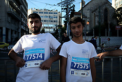November 13, 2016 - Athens, Attica, Greece - Syrian refugee team 'SolidarityNow' participates in the 34th Athens Classic Marathon in Athens, Greece, November 13, 2016. SolidarityNow participates with the first group of refugees in the history of the Marathon, which consists of 15 refugees. All the participants are asylum seekers and in the forthcoming future they will be relocated to another European country to start their new life. (Credit Image: © Giorgos Georgiou/NurPhoto via ZUMA Press)