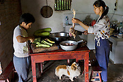 Preparation for lunch at the home of Lan Guihua, a widowed farmer in Ganjiagou Village, Sichuan Province, China. (From the book What I Eat: Around the World in 80 Diets.)