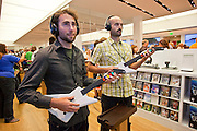 "Oct. 22, 2009 -- SCOTTSDALE, AZ:  WILL ROGGE, left, and ANDREW LAPUTKA, both from Los Angeles, play the game ""Beatles Rock Band"" on a Microsoft X-Box 360 at the new Microsoft store in Scottsdale, AZ, Thursday. Microsoft's first retail store opened in Fashion Square Mall in Scottsdale, AZ, Thursday. Microsoft's first foray into retail is widely considered to be a shot across the bows of Apple computers. The store's design is similar to Apple stores and the new Microsoft store is between two Apple stores, one in an upscale shopping mall five miles north of the Microsoft store, the other  in an upscale shopping area about 5 miles west of the Microsoft store. Microsoft used the occasion to officially launch the newest version of Windows 7, the newest version of Windows, Microsoft's flagship product.    Photo by Jack Kurtz"