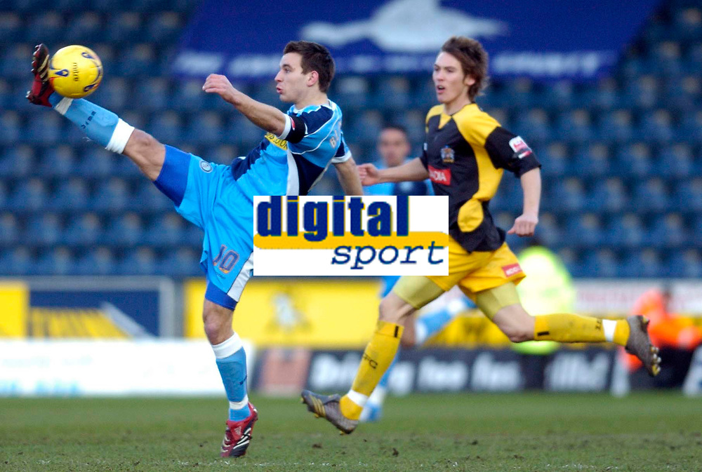 Photo: Alan Crowhurst.<br />Wycombe Wanderers v Stockport County. Coca Cola League 2. 28/01/2006. <br />Matt Bloomfield (L) of Wycombe clears the ball.