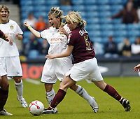 Photo: Chris Ratcliffe.<br /> Leeds United v Arsenal. Womens' FA Cup Final. 01/05/2006.<br /> Sue Smith (L) of Leeds tussles for the ball with Leanne Champ of Arsenal.