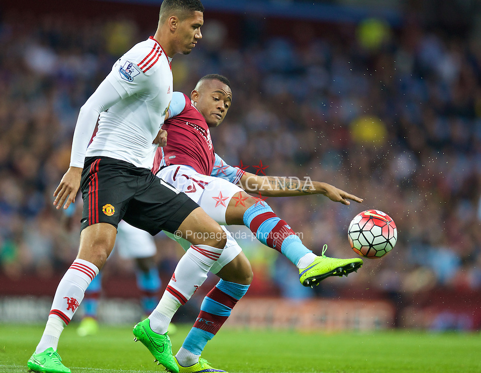 BIRMINGHAM, ENGLAND - Friday, August 14, 2015: Manchester United's Chris Smalling in action against Aston Villa's Jordan Ayew during the Premier League match at Villa Park. (Pic by David Rawcliffe/Propaganda)