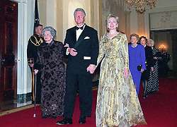 United States President Bill Clinton, center, escorts former first lady Lady Bird Johnson, left, and current first lady Hillary Rodham Clinton, right, to the 200th Anniversary of the White House Dinner in Washington, DC, USA,, USA on November 9, 2000. Also visible at right are former first lady Betty Ford, former first lady Rosalynn Carter, and former first lady Barbara Bush.<br /> Photo by Ron Sachs/CNP/ABACAPRESS.COM