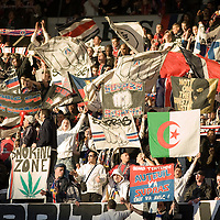 11 March 2007: Supporters of the french soccer team Paris Saint-Germain (PSG) Football Club hold banners of their group called Supras Auteuil in the Auteuil stands prior to the French League 1 football game won 1-0 by AJ Auxerre FC over Paris Saint-Germain (PSG) at the Parc des Princes stadium, in Paris, France.