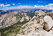 Climber on the summit of Tenaya Peak, Tuolumne Meadows area, Yosemite National Park, California USA