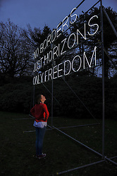 © Licensed to London News Pictures. 13/12/2018. Lydia Turnbull views 'No Borders' by Hilary Jack, newly unveiled at Yorkshire Sculpture Park. The 8m x 9m neon artwork explores the politics of location, physical boundaries and personal freedoms. It displays the words of Amelia Earhart, the pioneering and much celebrated American aviator who was the first woman, and only the second person, to fly solo across the Atlantic Ocean. Earhart vanished without trace during an attempt to circumnavigate the globe in 1937. Picture credit: Scott Merrylees/LNP