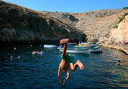 MALTA WIED IZ ZURRIEQ 23JUL06 - Local Maltese enjoy a dip in the warm Mediterranean water to cool off in the afternoon heat near the Blue Grotto, Malta...jre/Photo by Jiri Rezac..© Jiri Rezac 2006..Contact: +44 (0) 7050 110 417.Mobile:  +44 (0) 7801 337 683.Office:  +44 (0) 20 8968 9635..Email:   jiri@jirirezac.com.Web:    www.jirirezac.com