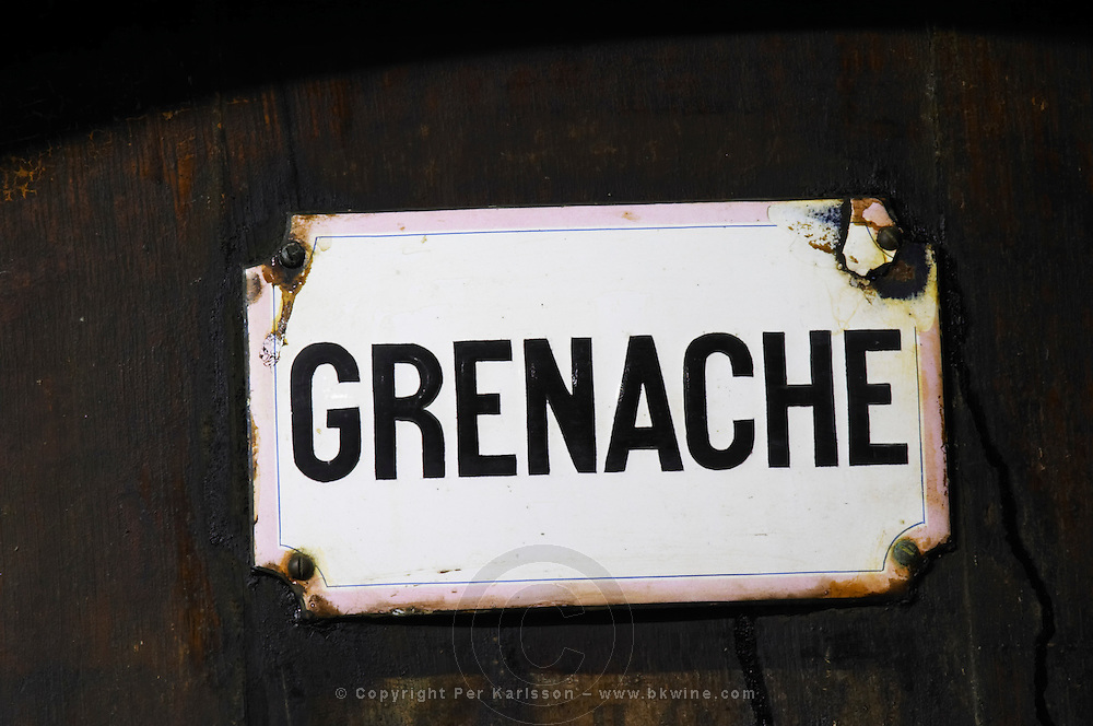 Grenache, rusty sign. Chateau de Nouvelles. Fitou. Languedoc. Barrel cellar. France. Europe.