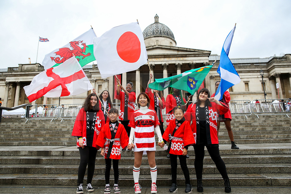 """© Licensed to London News Pictures. 29/09/2019. London, UK. Performers waves flags of Japan, England, Scotland and Wales on the steps of Trafalgar Square during the  annual Japan Matsuri festival of Japanese music, food and culture. The concept of the theme this year is """"Future generations"""". Photo credit: Dinendra Haria/LNP"""