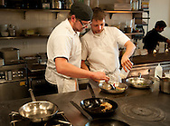 5 MAY 2014 -- CLAYTON, Mo. -- Kitchen staff at Niche, including Ricky Whalen (left) and Adam Altnether, work under the supervision of chef Gerard Craft (not pictured) as the James Beard Foundation's annual awards are announced in New York Monday, May 5, 2014. Craft was one of two St. Louis chefs competing for the Best Chef: Midwest award in the 2014 competition, which was won by Justin Aprahamian of Milwaukee. Photo © copyright 2014 Sid Hastings.