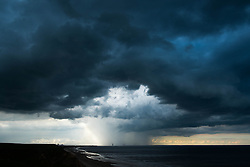 © Licensed to London News Pictures. <br /> 10/06/2014. <br /> <br /> Saltburn, United Kingdom.<br /> <br /> Dark thunder clouds form over Teesside.<br /> <br /> Photo credit : Ian Forsyth/LNP