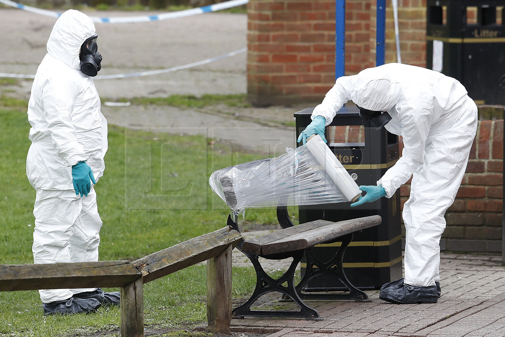 © Licensed to London News Pictures. 23/03/2018. Salisbury, UK. Police in protective suits and gas masks are seen working around the bench where former Russian spy Sergei Skripal and his daughter Yulia were poisoned with nerve agent in Salisbury. The couple where found unconscious the bench in Salisbury shopping centre. Photo credit: Peter Macdiarmid/LNP