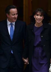 © Licensed to London News Pictures. 09/05/2012. Westminster, UK British Prime Minister David Cameron and his wife Samantha Cameron leave Downing Street for the opening, The procession carrying Queen Elizabeth II on its way to the Palace of Westminster today 9th May 2012. It is the first Queen's Speech, the grandest event on the parliamentary calendar, since shortly after the coalition Government was formed. The statement usually takes place each autumn. Photo credit : Stephen Simpson/LNP