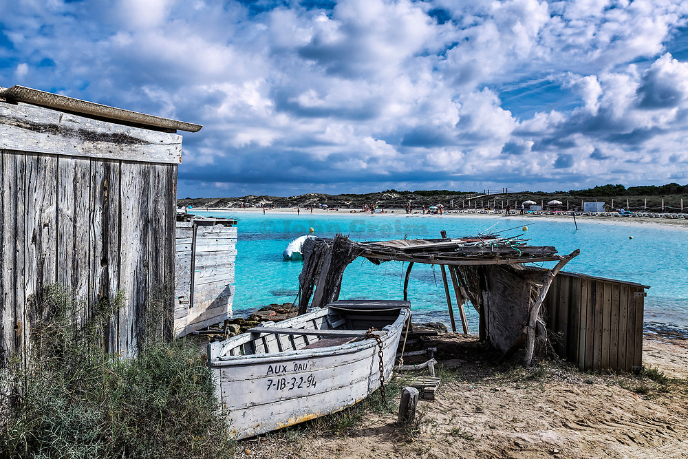 Boat and boat shed, Playa des ses Illetes, Formentera, Balearic Islands, Spain.