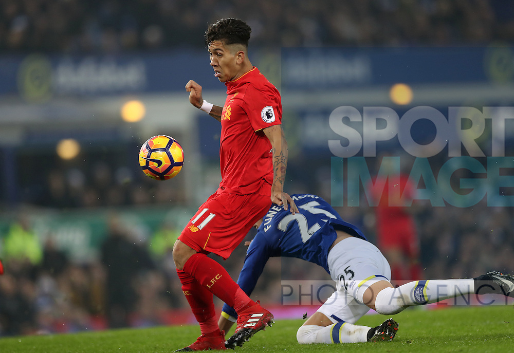 Roberto Firmino of Liverpool beat Ramiro Funes Mori of Everton during the English Premier League match at Goodison Park, Liverpool. Picture date: December 19th, 2016. Photo credit should read: Lynne Cameron/Sportimage